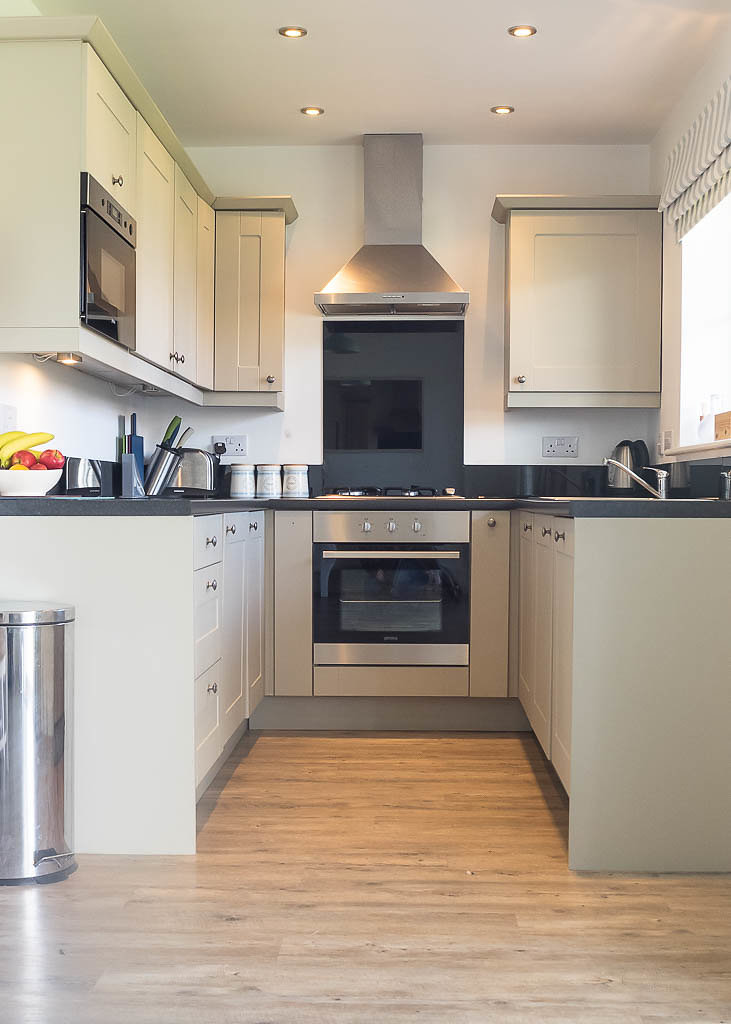 Fully-fitted kitchen with fridge, washer-dryer, dishwasher, microwave, gas hob and electric oven